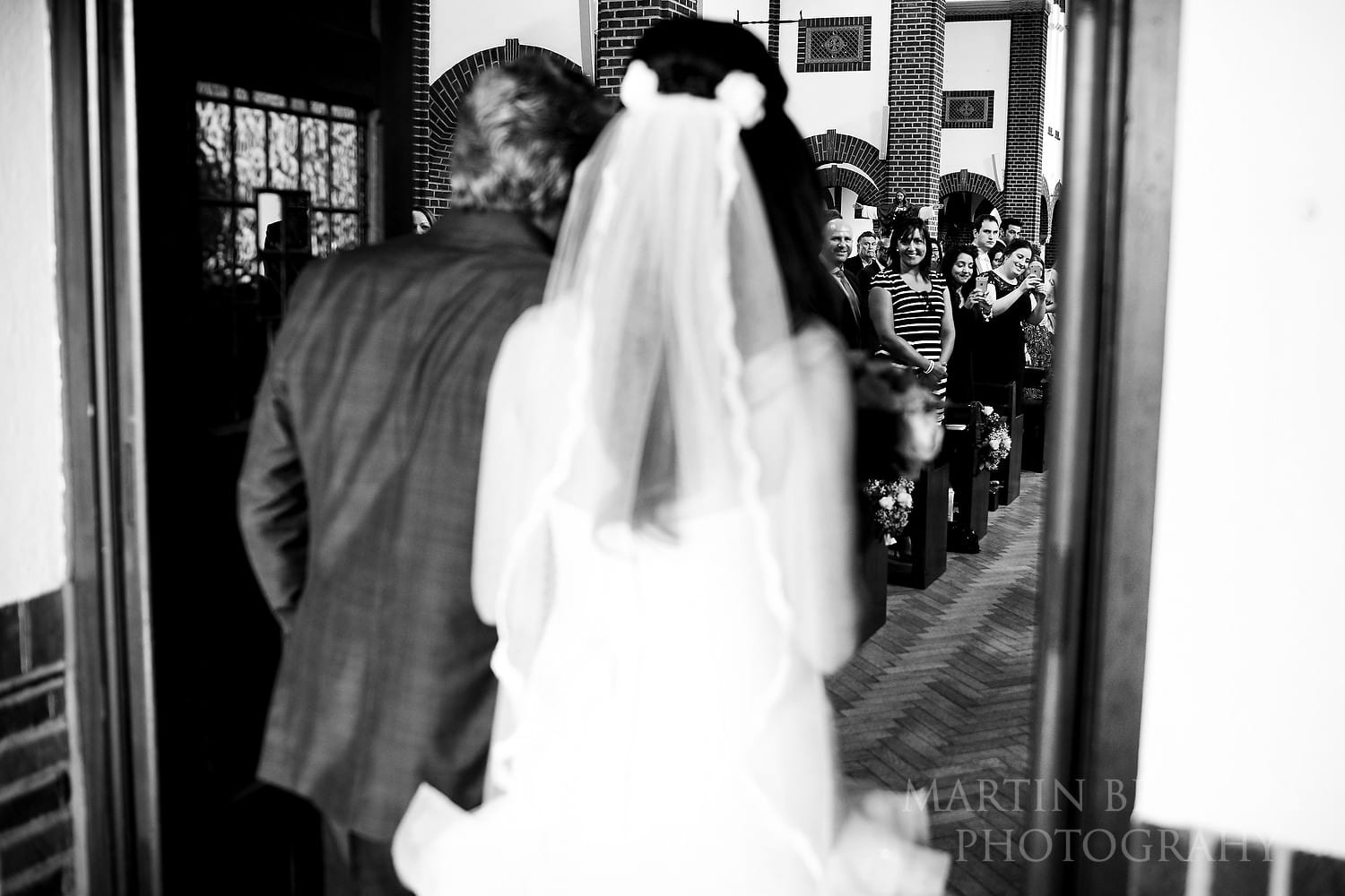 Guests look on as the bride enters the church