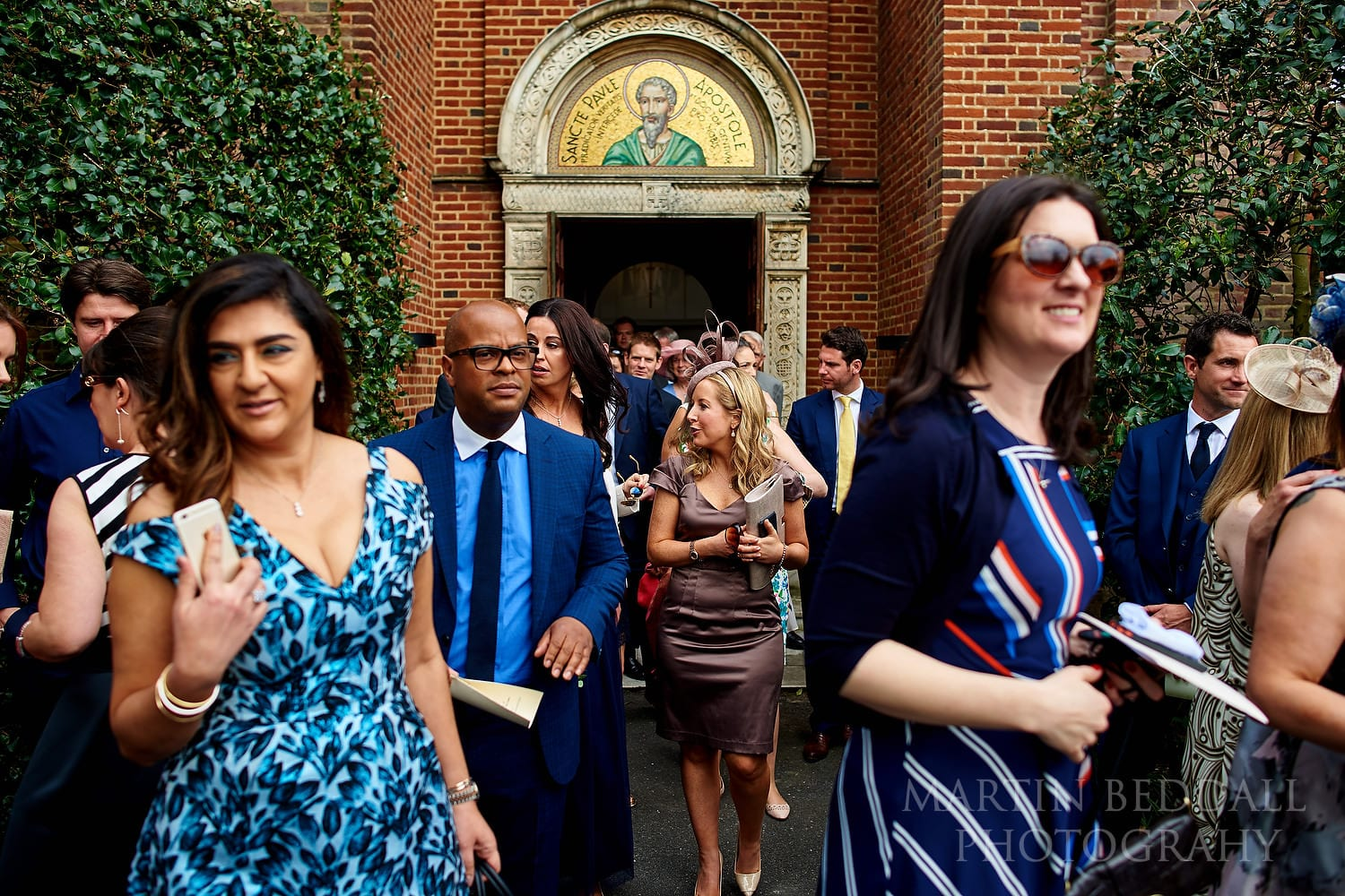 Guests leave the church