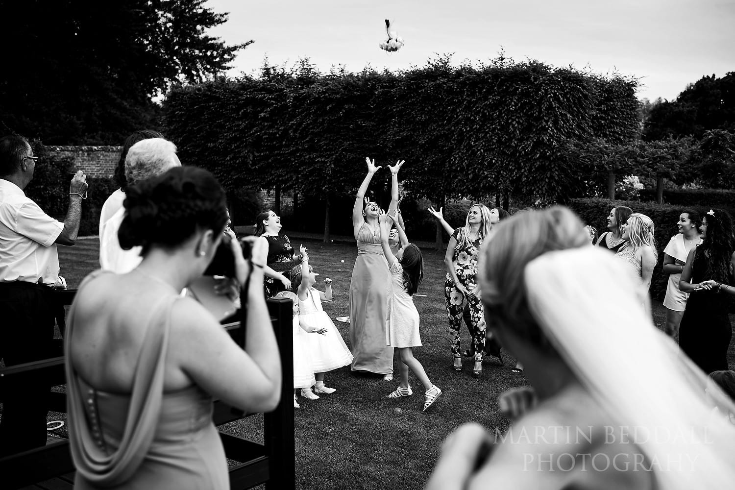 Catching the bride's bouquet at Braxted Park