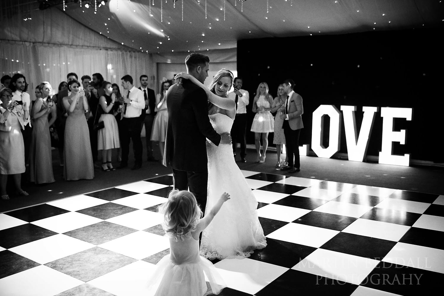Their young daughter wants to join in the first dance
