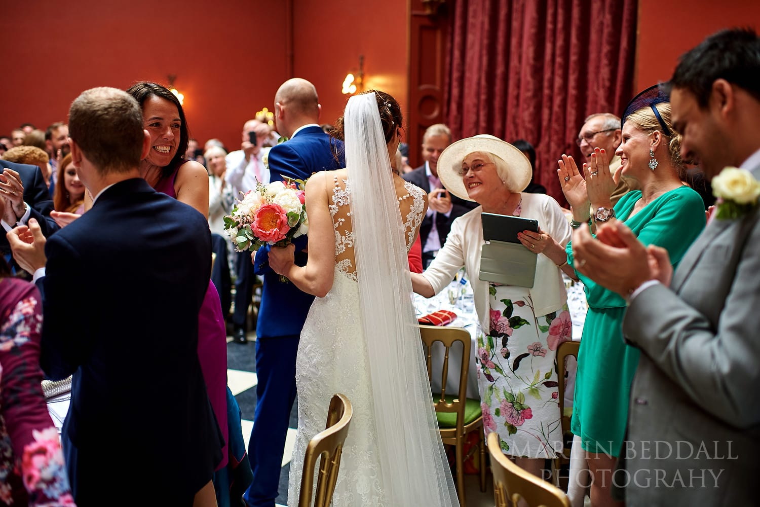 Bride and groom enter for dinner at Hampton Court House
