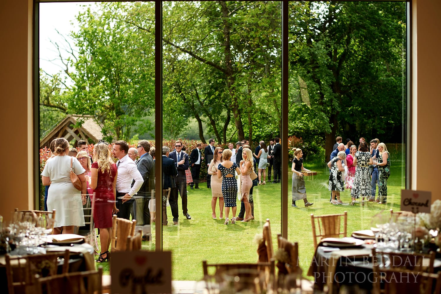 Guests on the lawn at Millbridge Court wedding reception