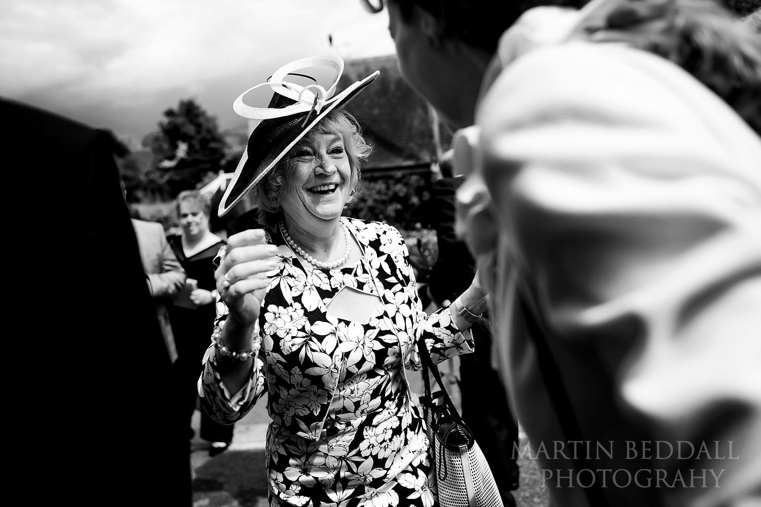 Wedding guest greetings outside Fontmell Magna church