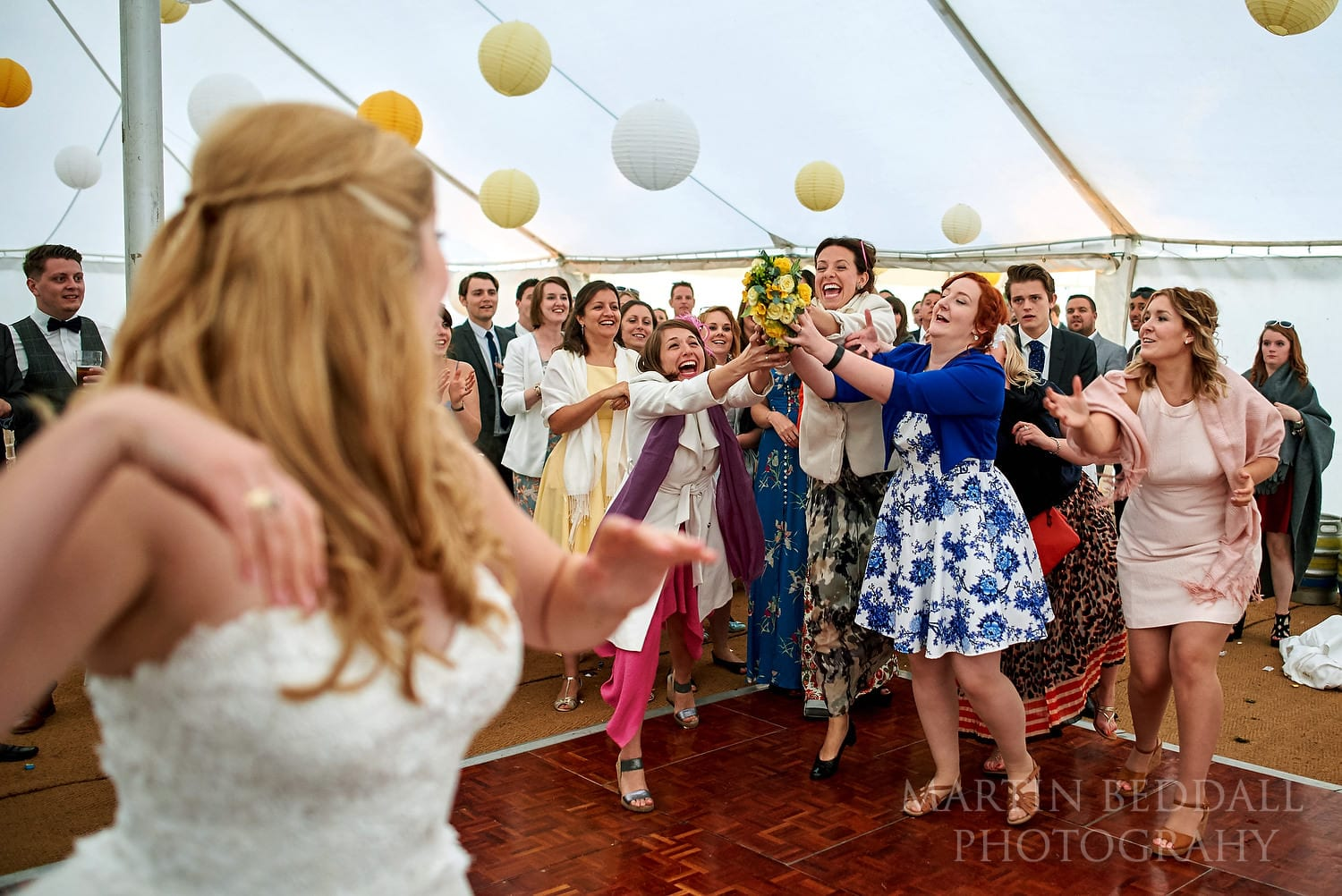 Catching the bride's bouquet at Hatch House wedding