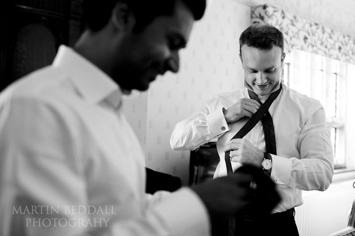 Groom getting ready at Hever Castle