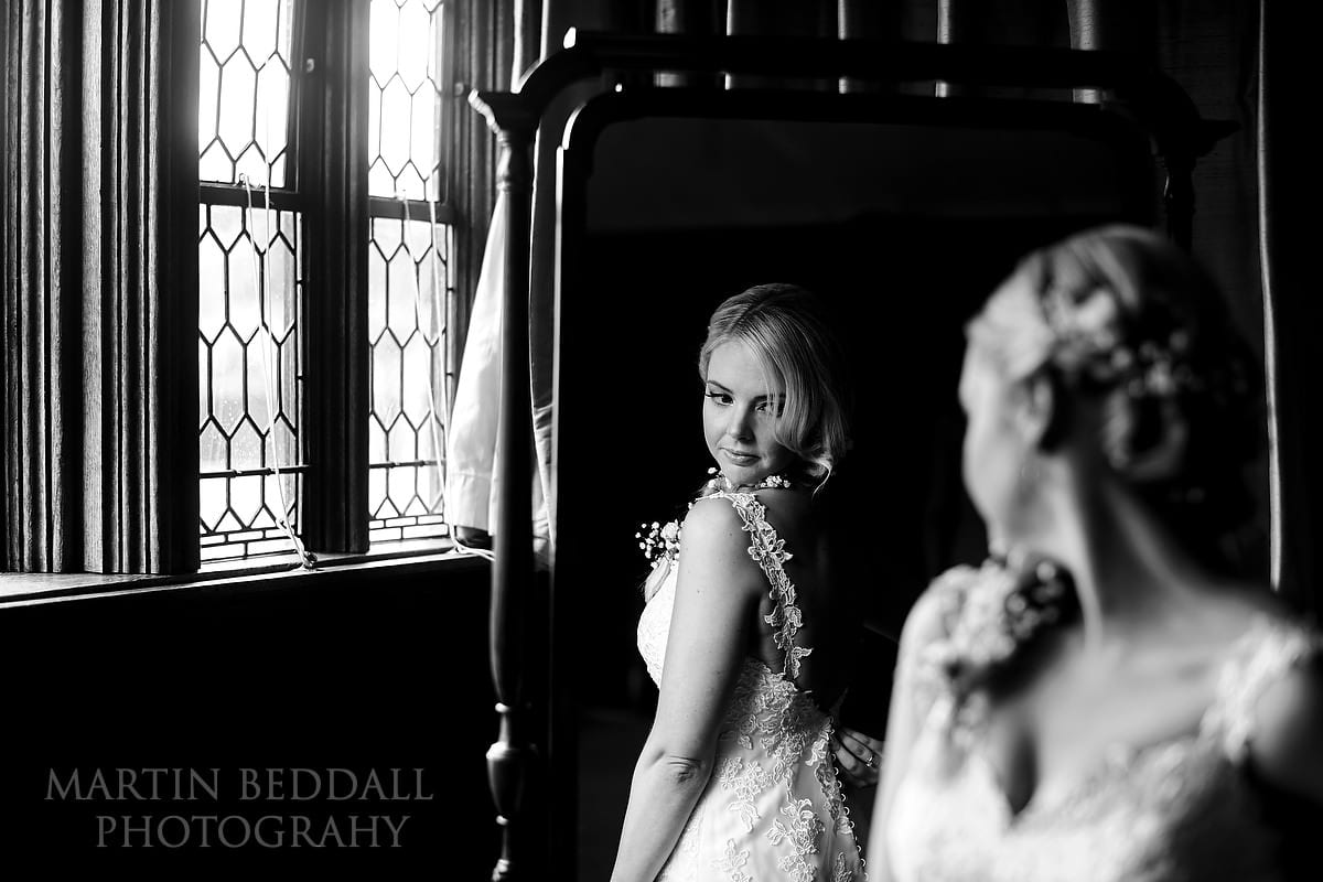 Bride checks out her dress in the mirror