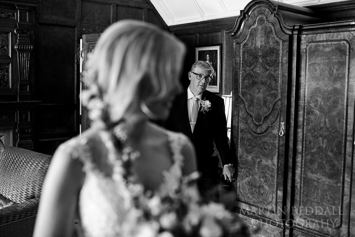 Bride's father arrives to escort his daughter