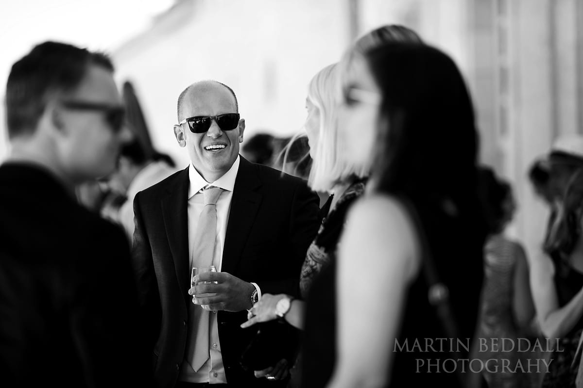 Drinks in the shade before the wedding ceremony at Château Soutard