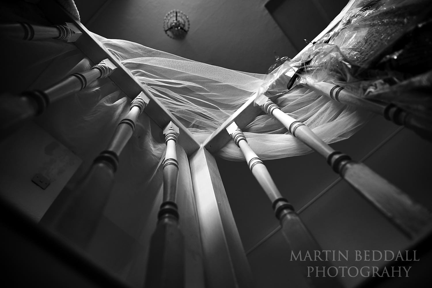 Bride's veil hanging on the bannister