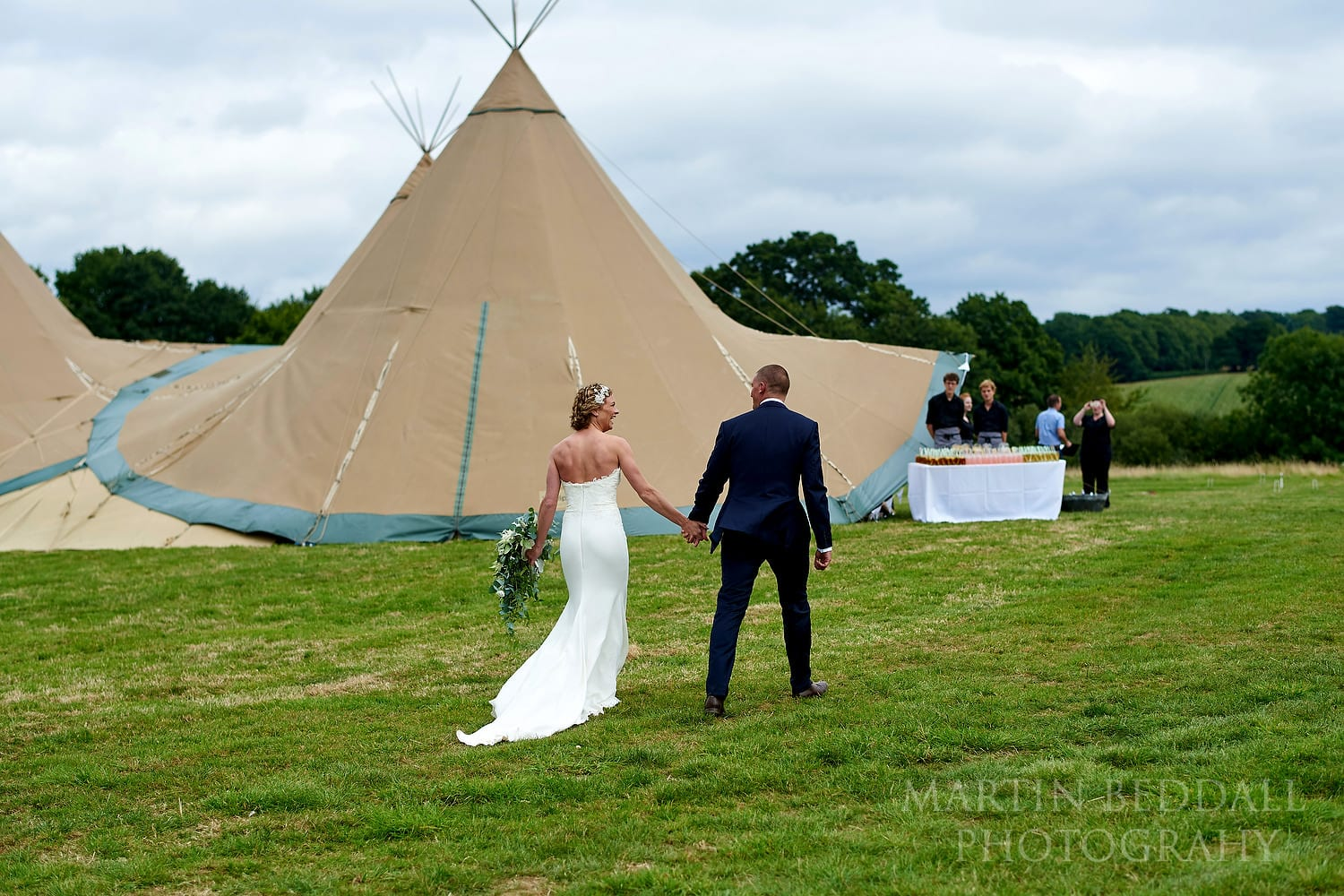 Bride and groom heading to the tipi at Chafford Park wedding