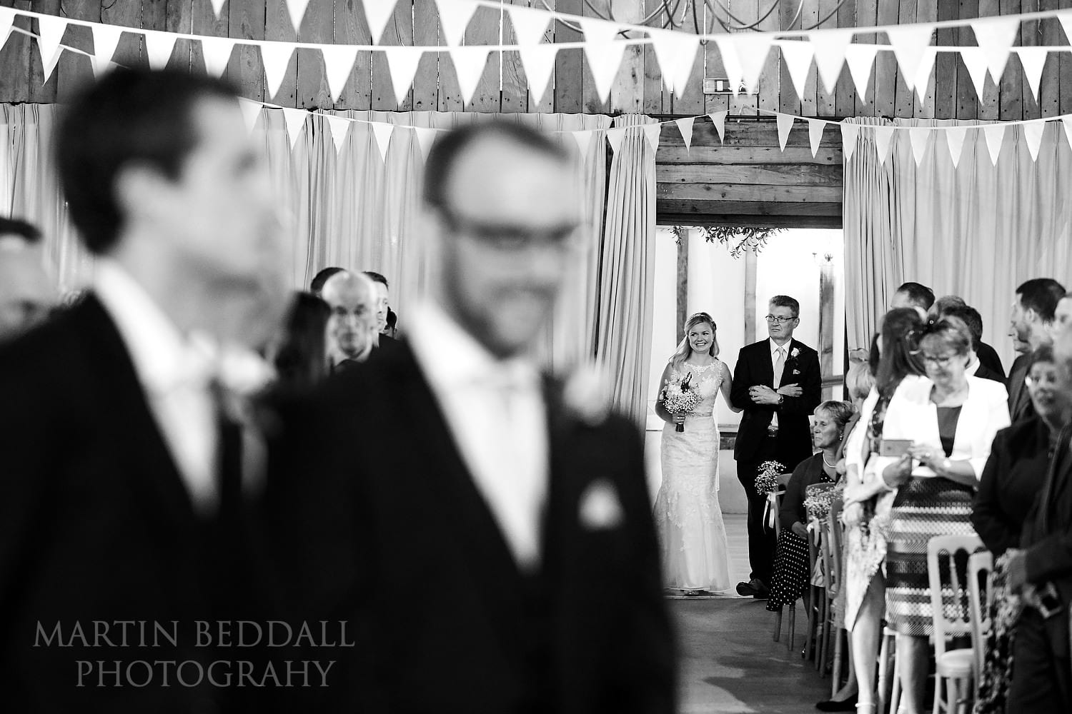Clock Barn wedding starts with the entrance of the bride and her father