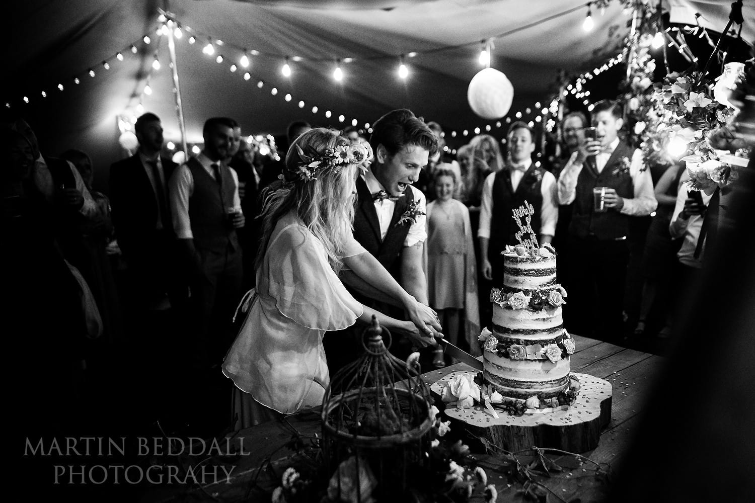 Cutting the wedding cake at East Sussex wedding