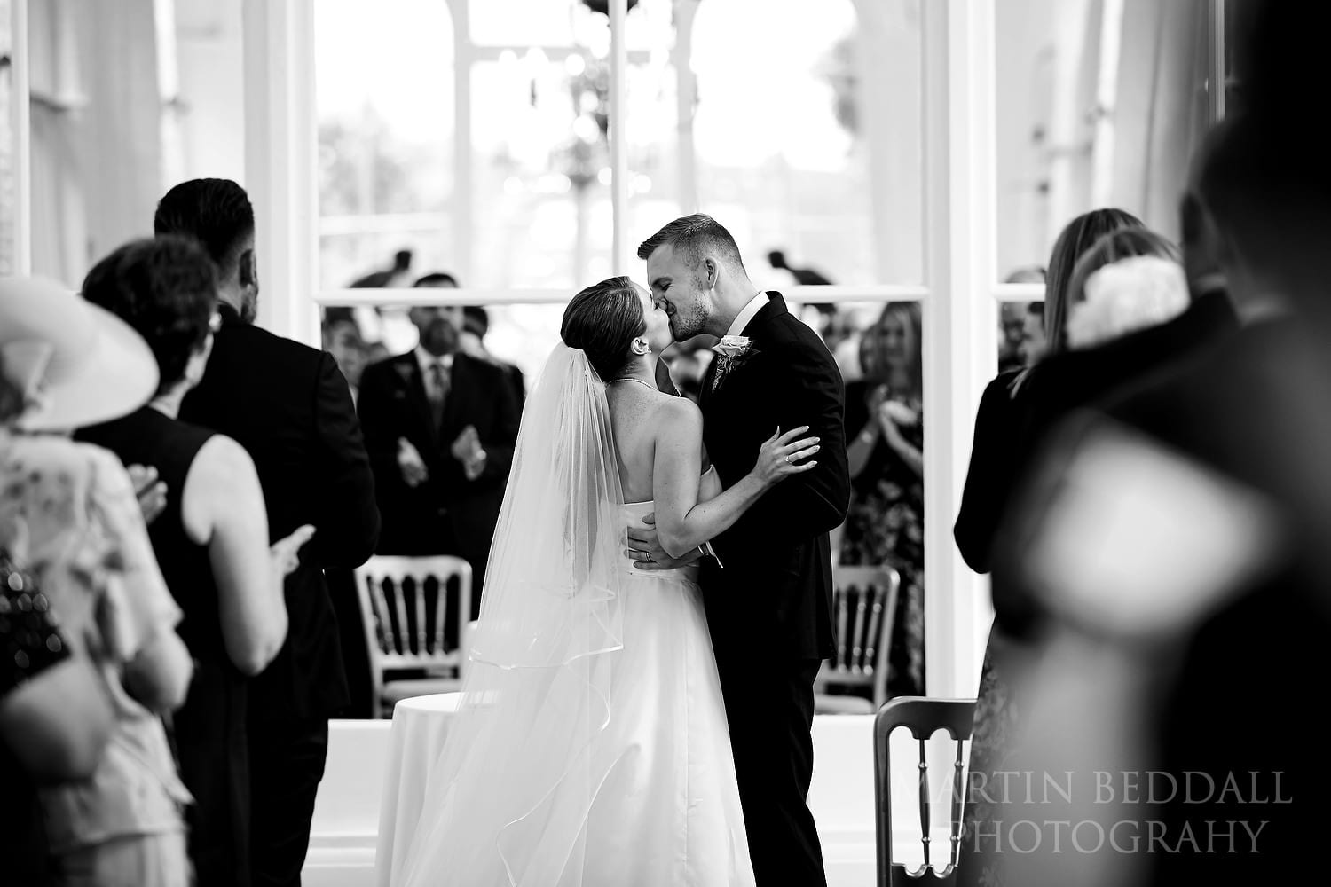 Orangery wedding kiss