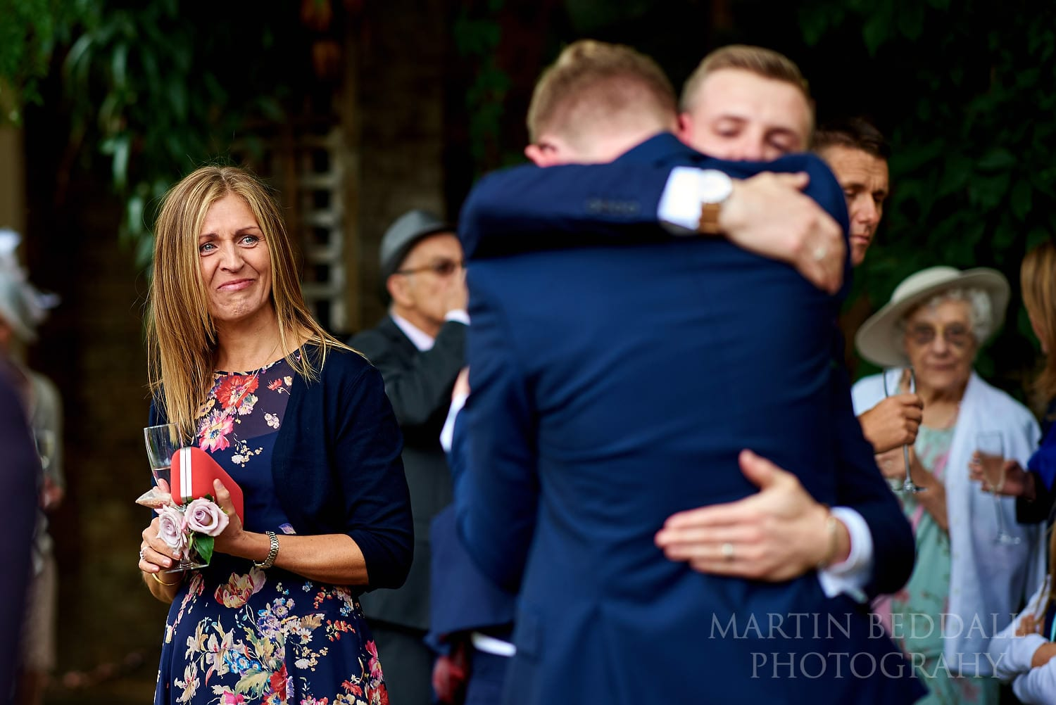 Mother watches her sons hug