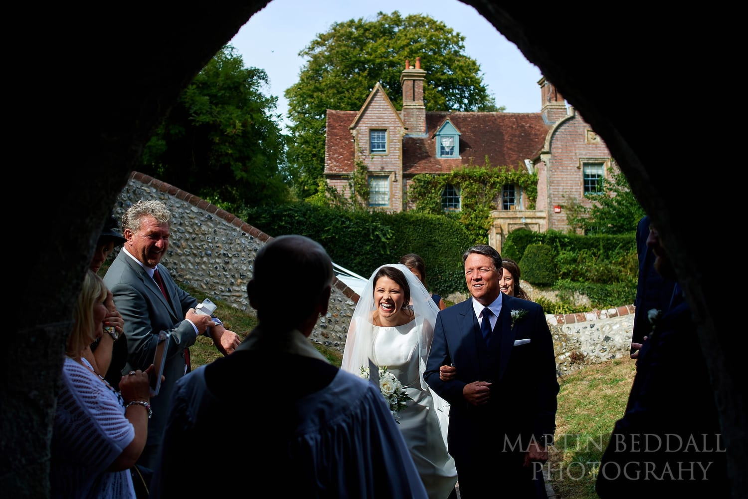 Bride and her father arrive at Folkington church in Sussex