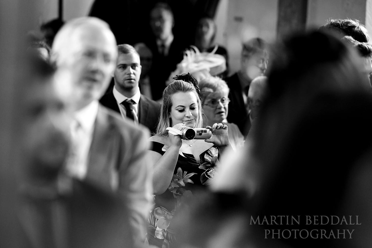 Guest filming the wedding ceremony