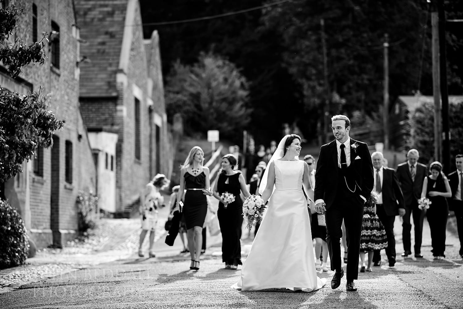 Brie and groom lead the guests to the reception at Folkington Manor