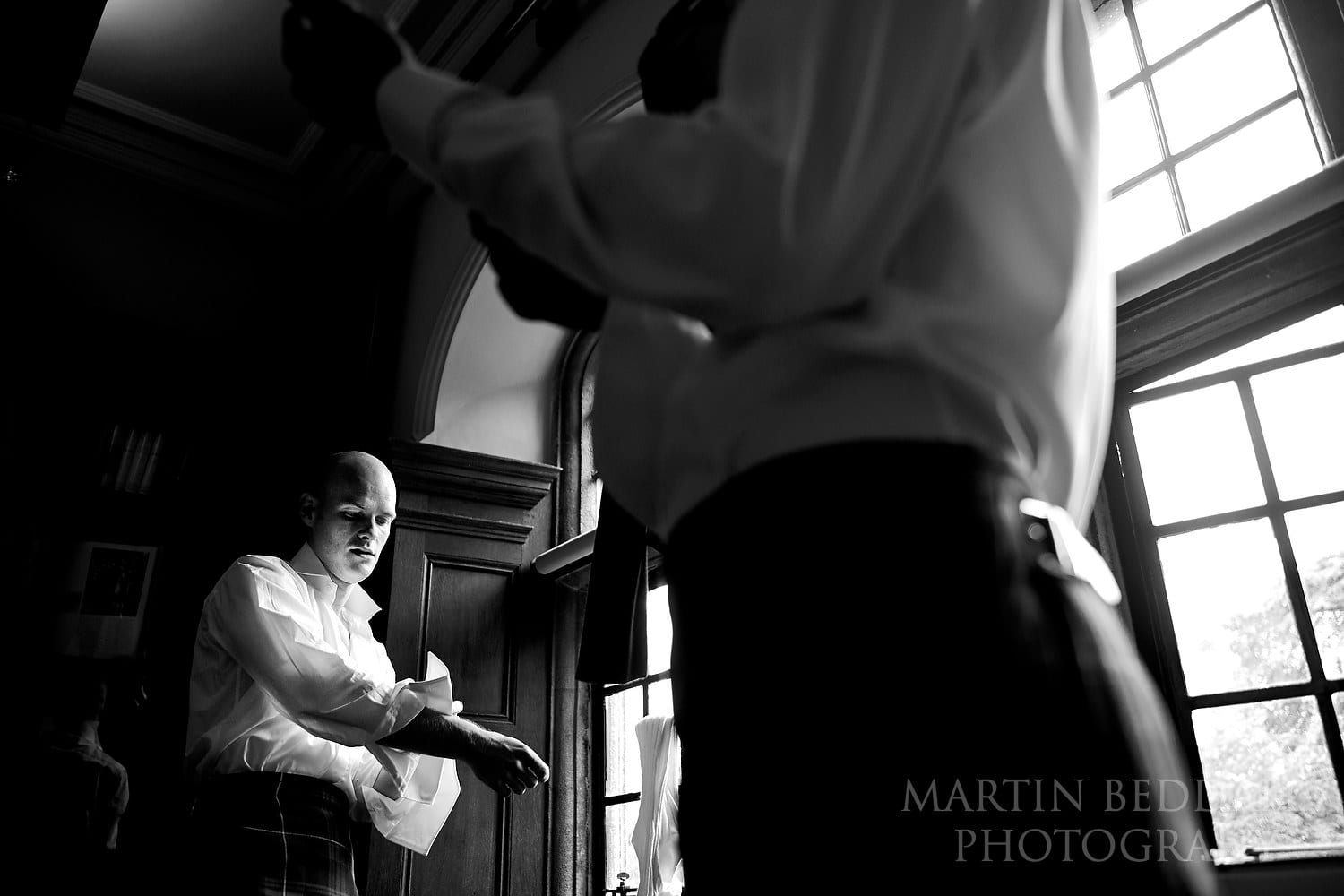 Groom getting ready at Oxford college