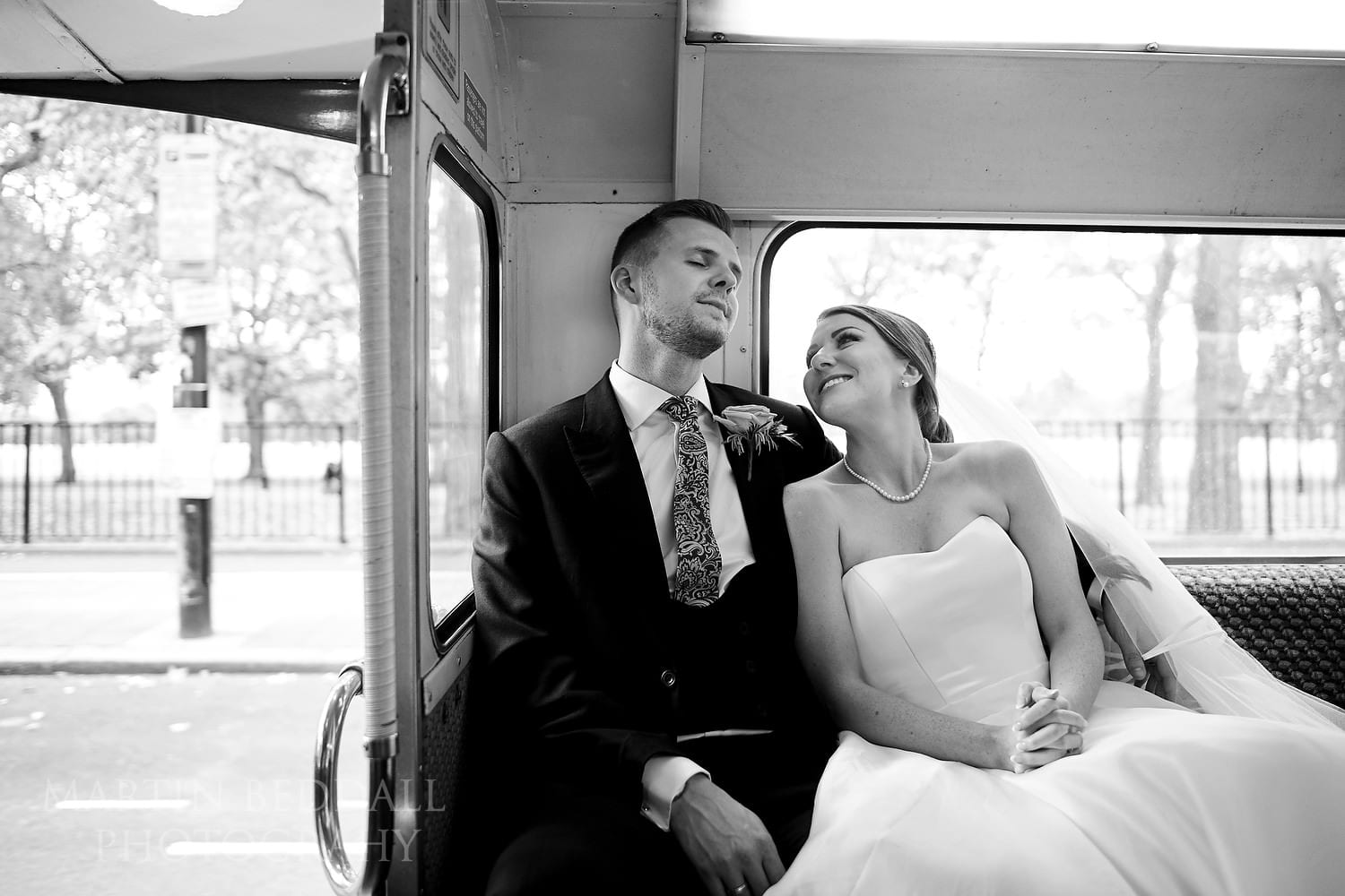 Bride and groom on the bus