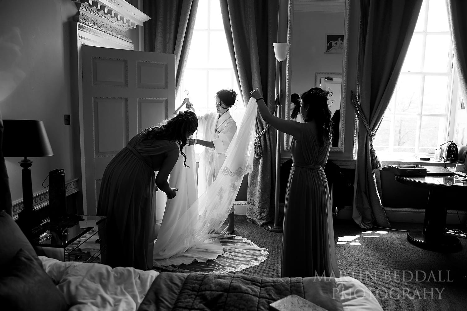 Bride unpacks her wedding dress at Buxted Park