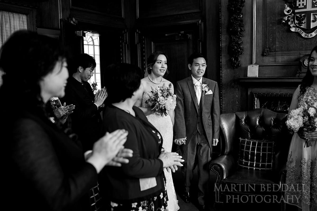 Bride and groom enter the small London wedding venue called the Mayor's Parlour