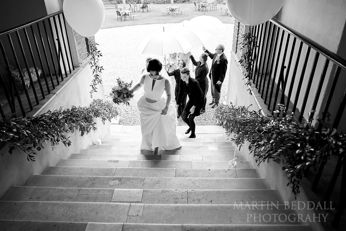 Bride makes her way to the ceremony at Farnham Castle