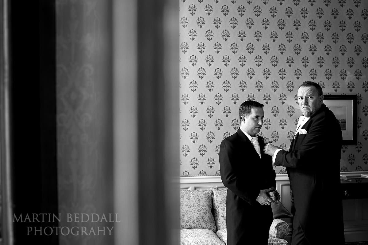 Best Man helping the groom at Horsted Place