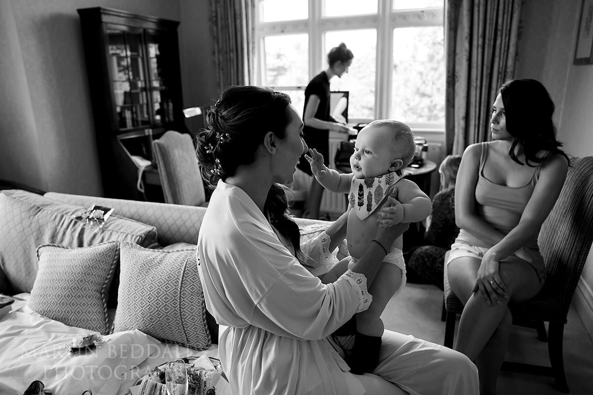 Bride plays with her young son