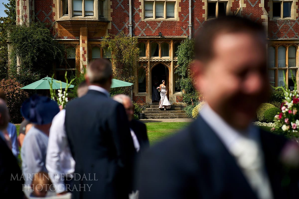 Bride heads out of Horsted Place for the ceremony