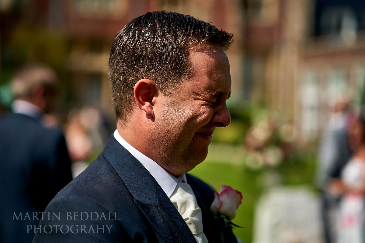 Tearful groom after seeing the bride at Horsted Place