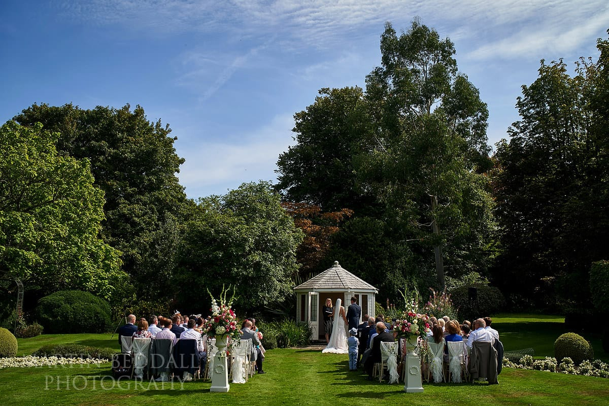 Outdoor wedding ceremony at Horsted Place in Sussex