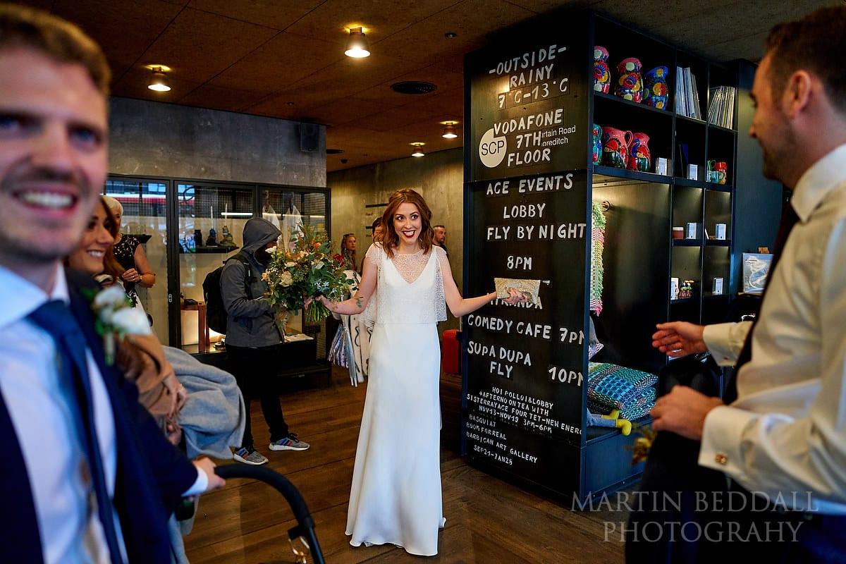 Bride meets the groom in the hotel lobby