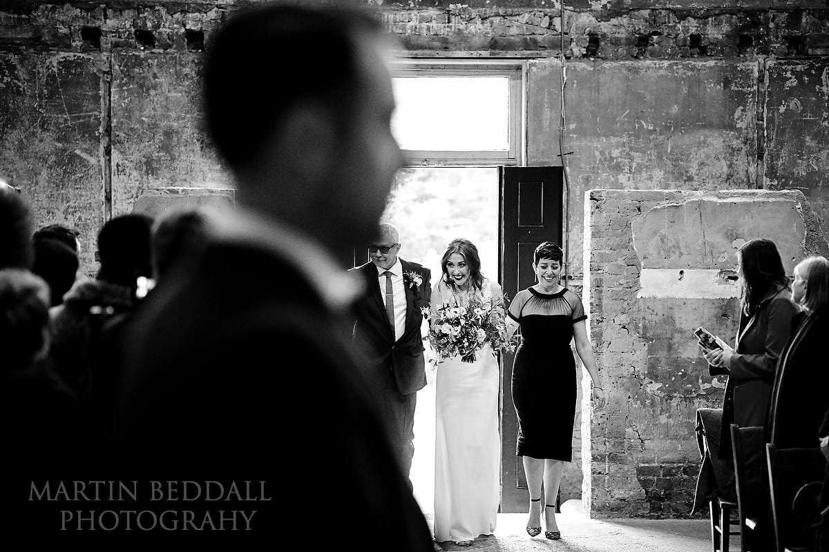Bride enters the Asylum Chapel with her mother and father