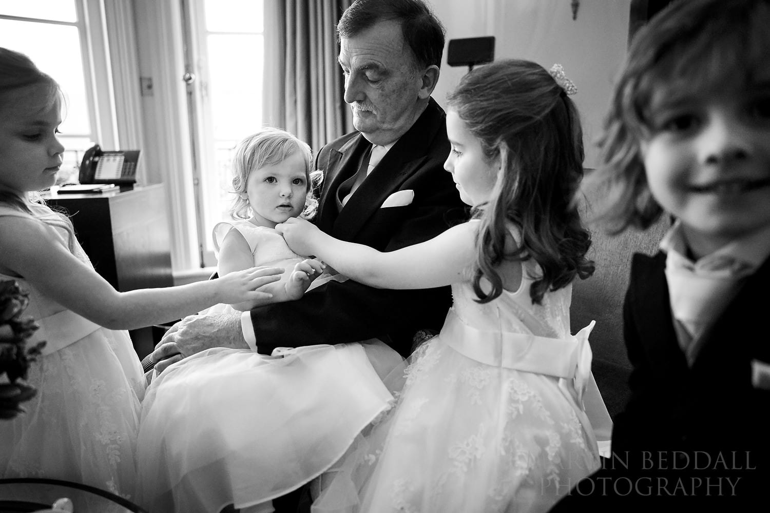 Bride's father with his granddaughter