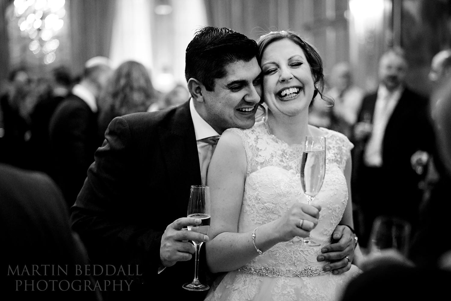 Natural moment between the bride and groom at Claridges wedding
