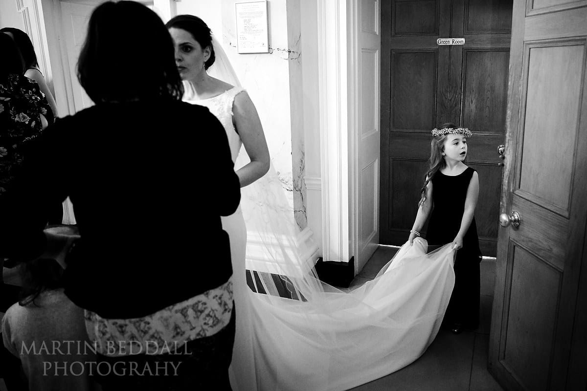 Holding the bride's dress