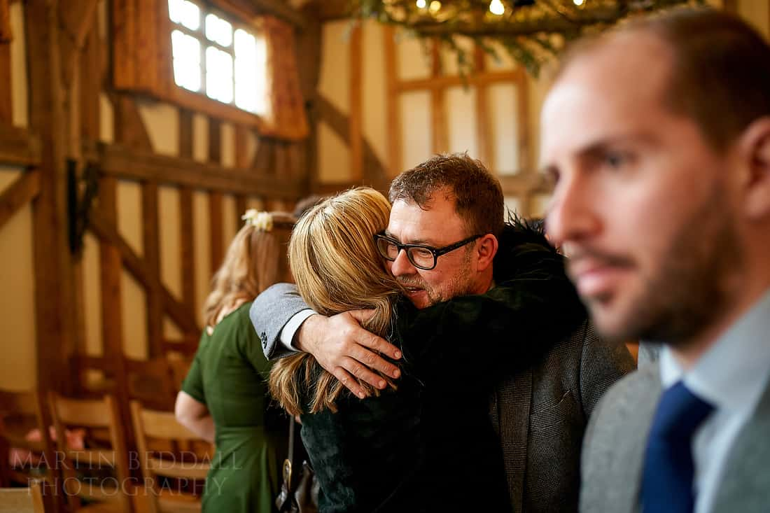 Wedding guests gather for the ceremony in the barn at Gate St