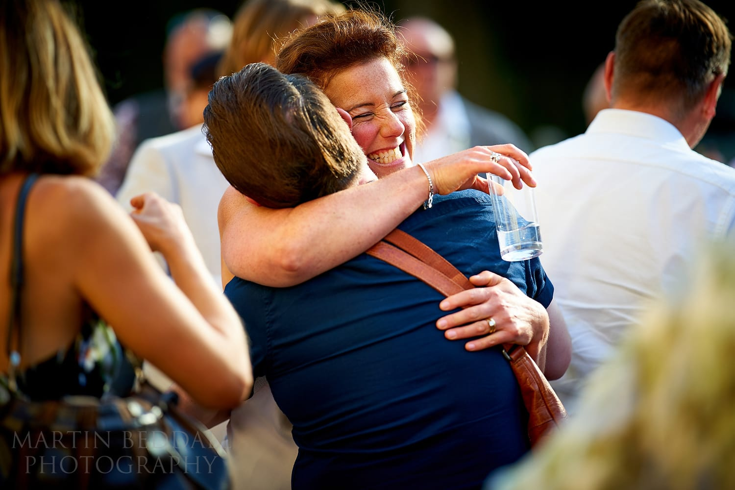 Bride hugs a friend shot with the Sony FE 135mm f1.8 GM lens