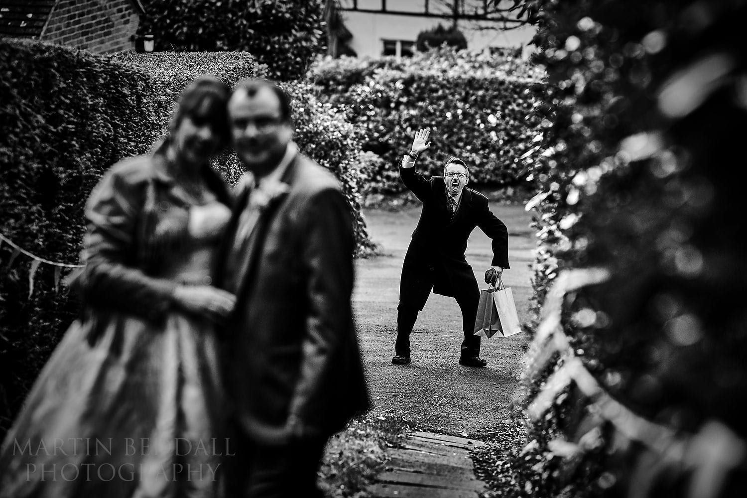 Wedding guest photobombs the couple portrait