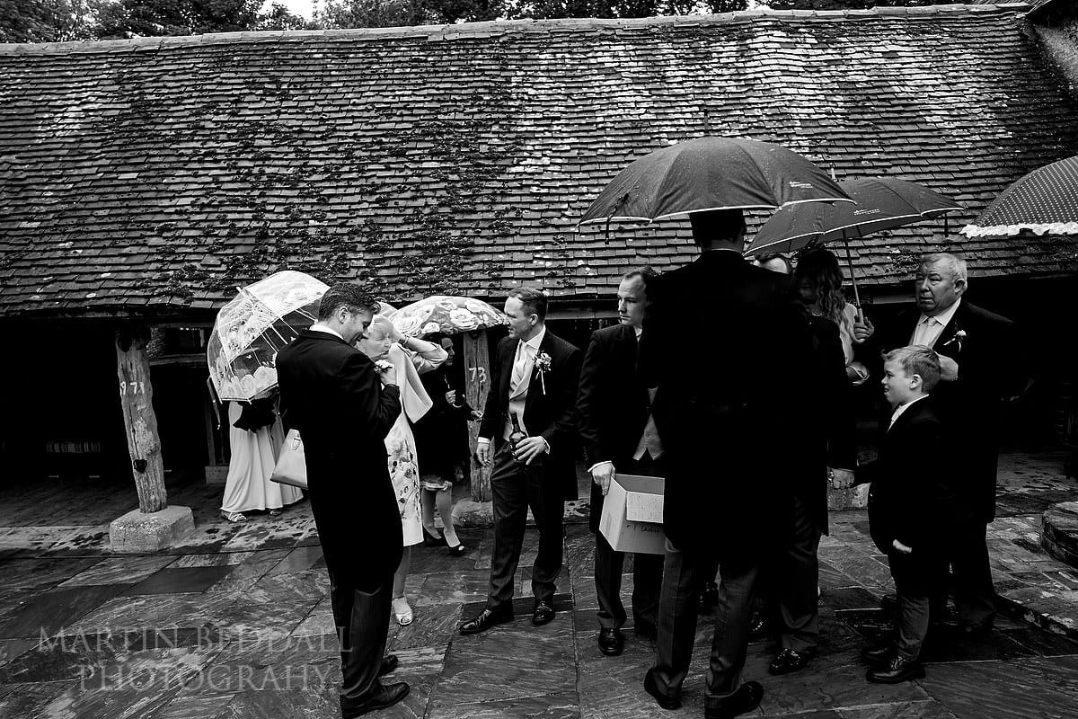 Ready to head to the ceremony barn at Wet wedding at Cissbury Barns