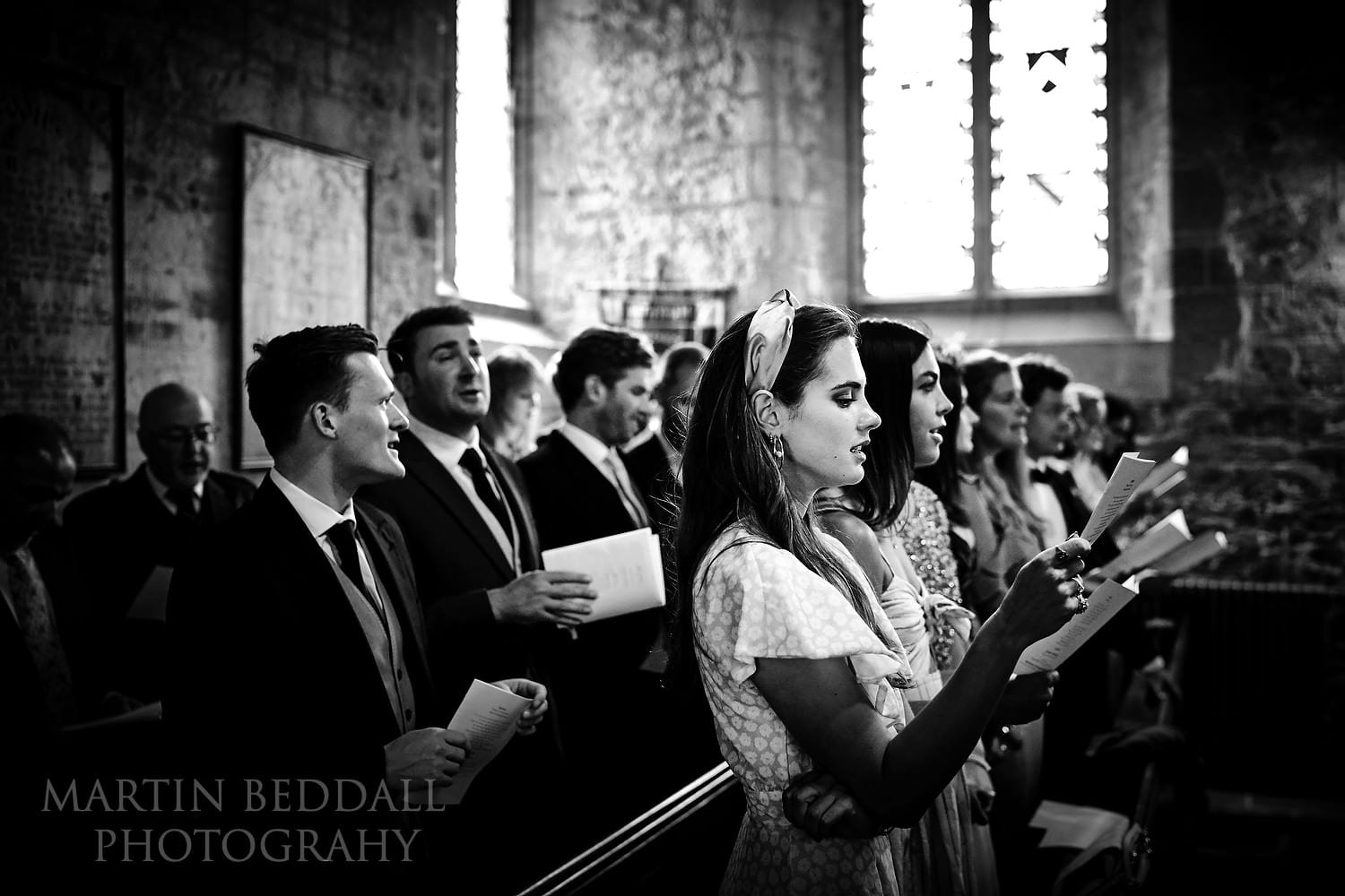 Guests singing hymns