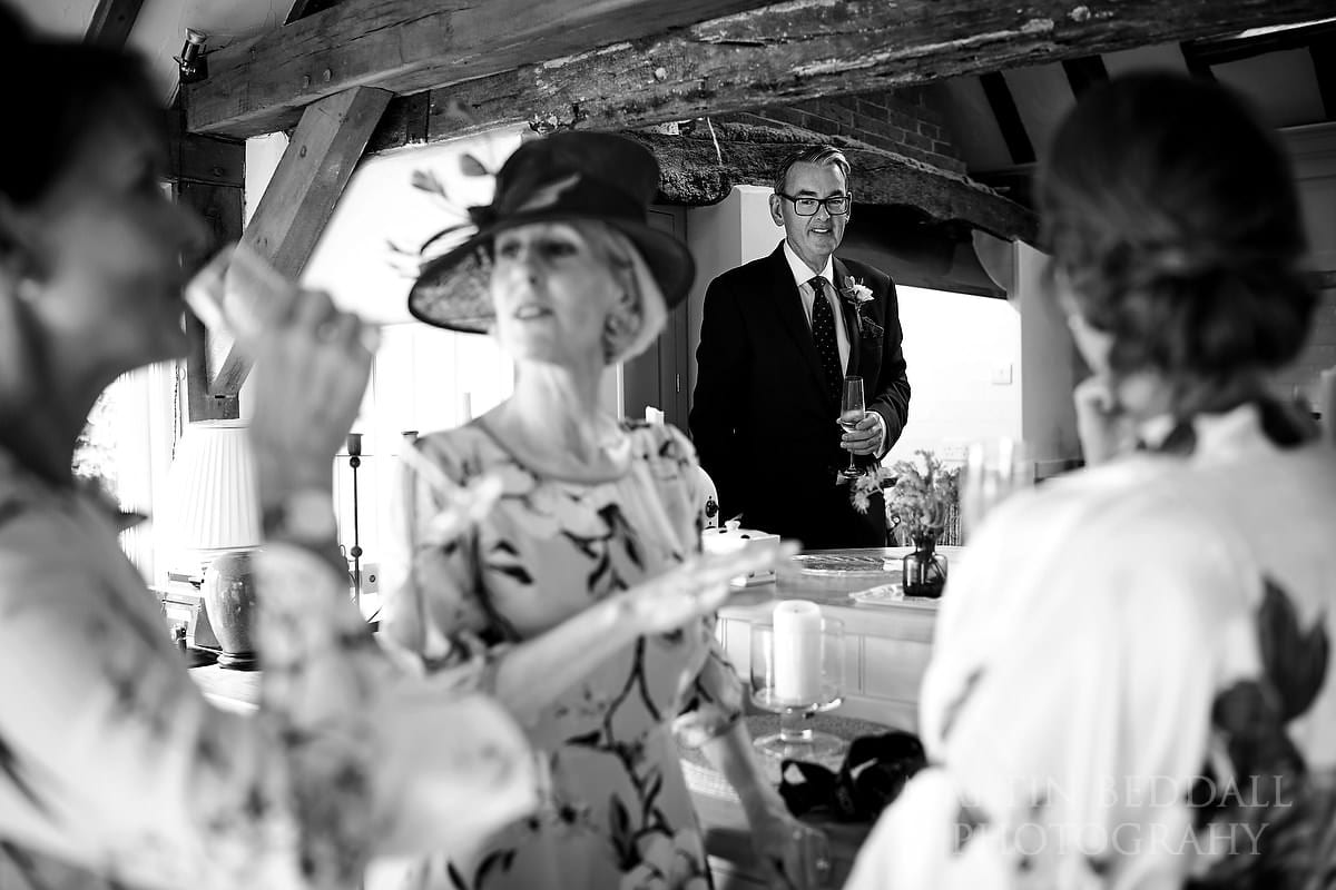 Father of the bride watches on