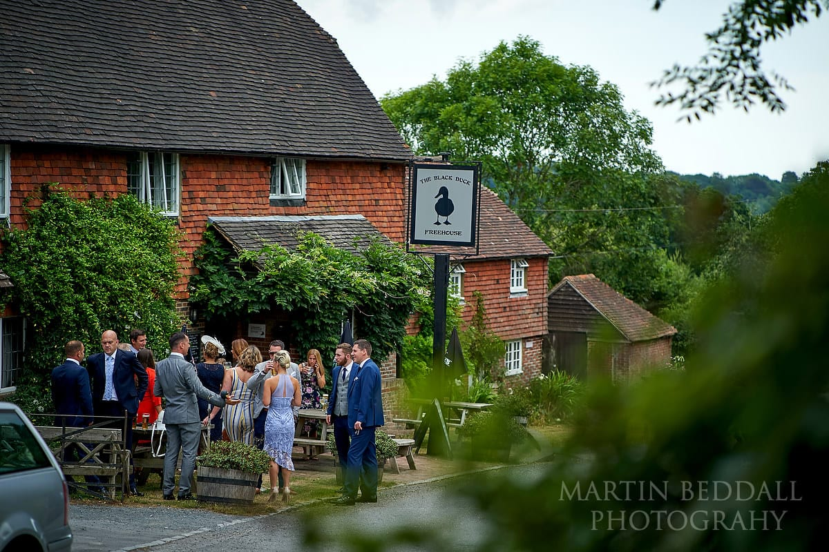 Groom and guests outside the village pub