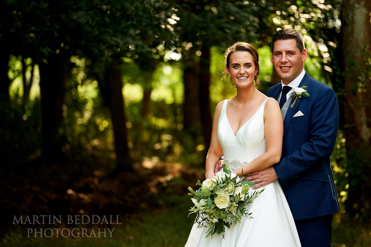 Couple portrait at Marquee in the garden wedding