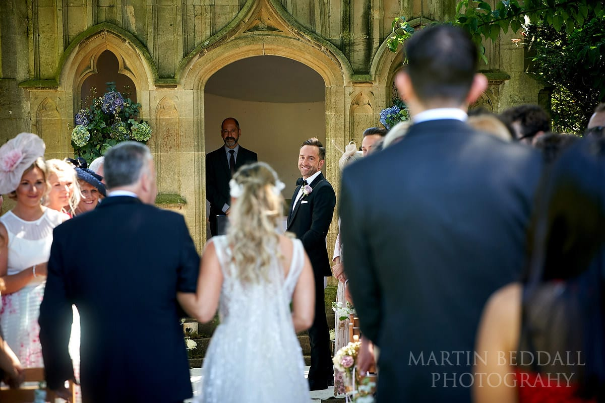 Groom at the end of the aisle