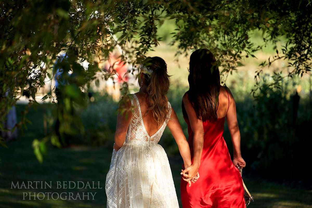 Bride and her friend in the dappled sunlight