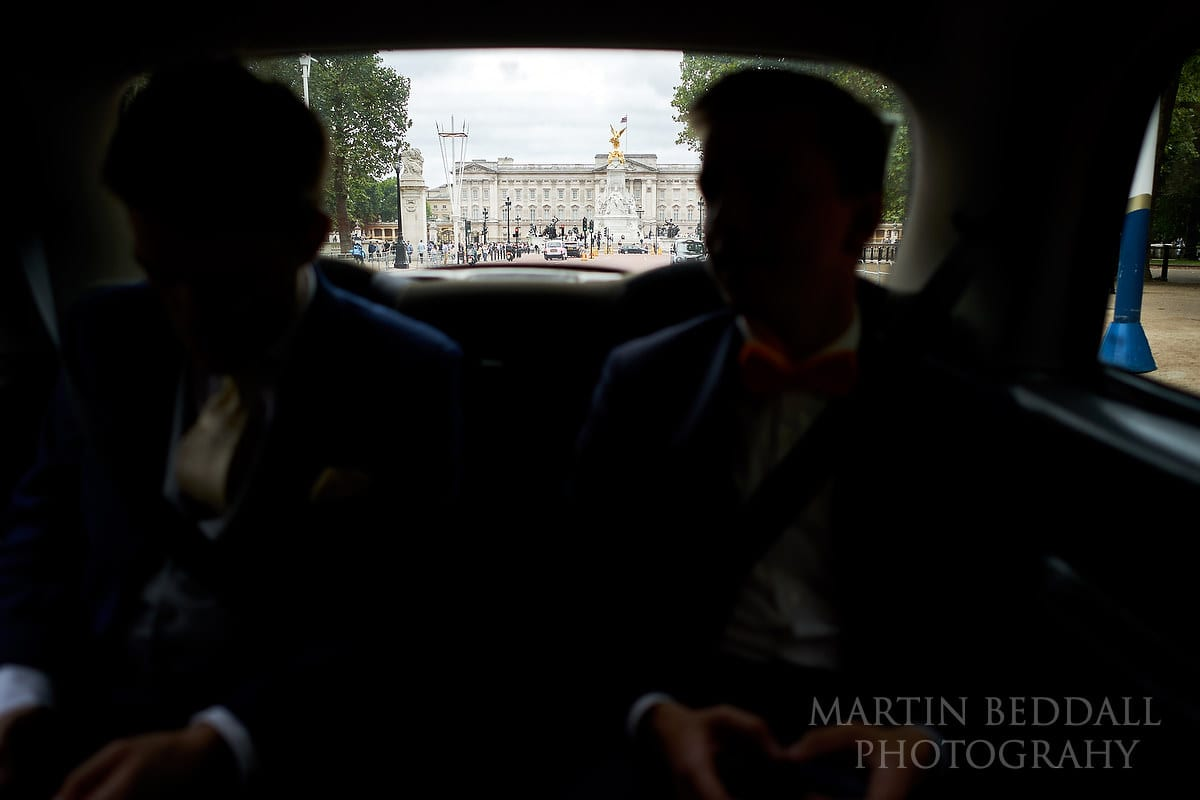 Groom and groomsmen in a black cab heading to the Bloomsbury House wedding