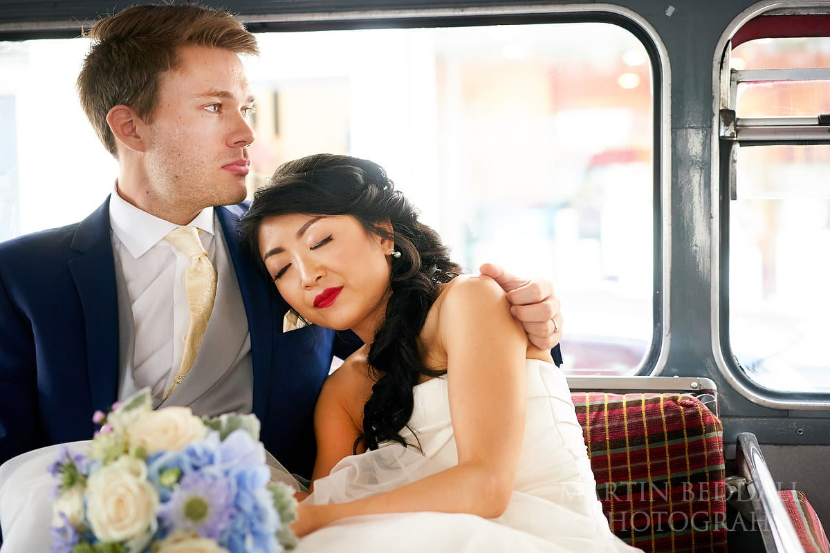 Bride and groom on the wedding bus