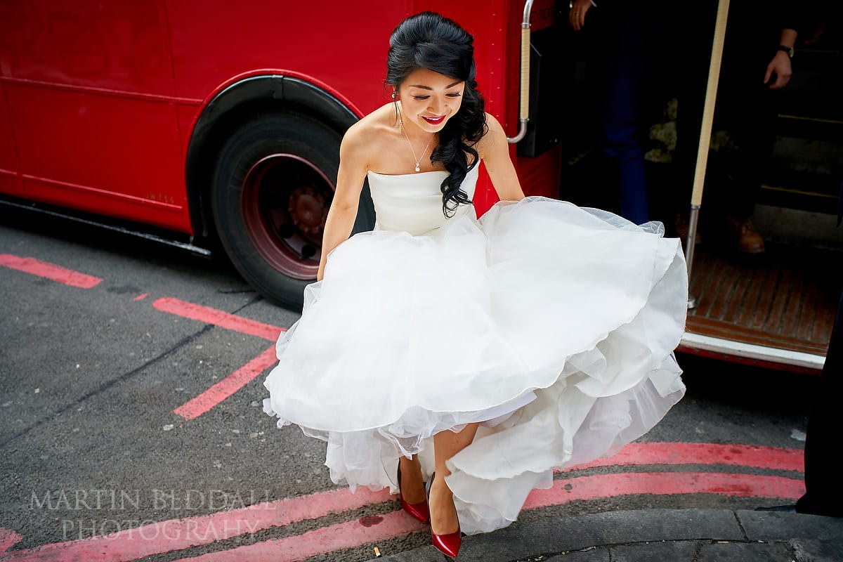 Bride steps out of thr red Routemaster bus