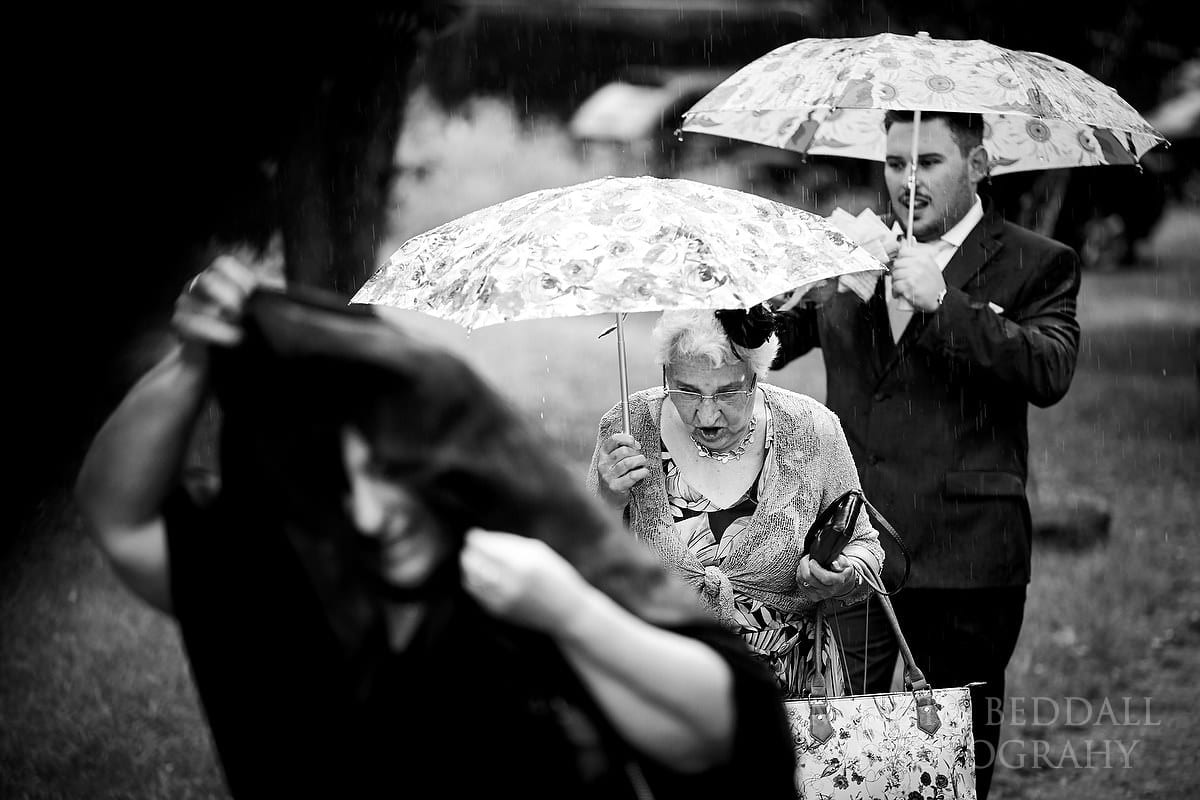 Guests arrive in the rain at Five Oaks Events near Horsham